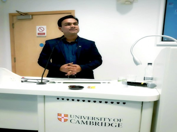 Dr. Tarik is delivering a lecture at the University of Cambridge